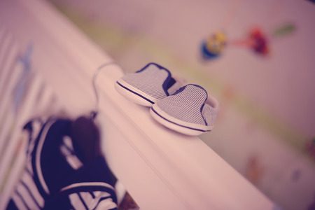 bassinet: Child shoes on wooden bed