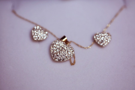 bead jewelry: Heart shaped neck chain with crystals Stock Photo