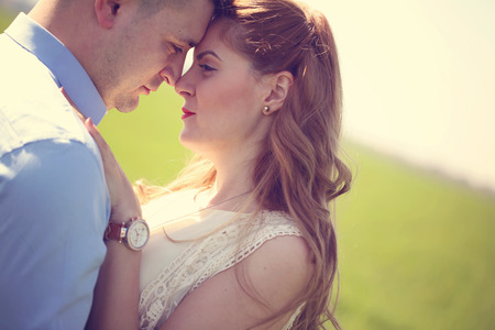 lovely couple: Portrait of lovely couple in the sunlight Stock Photo