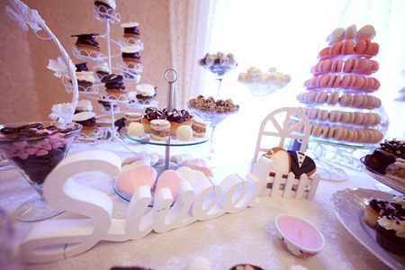 wedding: Delicious small cakes on beautifully decorated wedding table Stock Photo