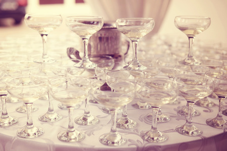 a marriage meeting: Many glasses of wine on table Stock Photo