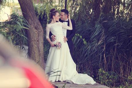 multi story: Beautiful bridal couple near trees
