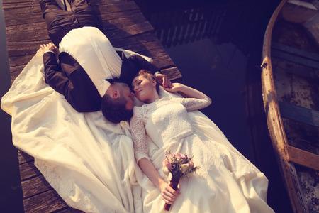 multi story: Bride and groom near lake