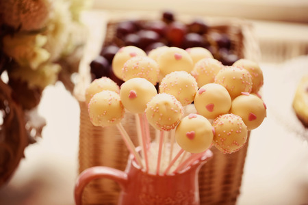 childrens birthday party: White cake pops on table Stock Photo