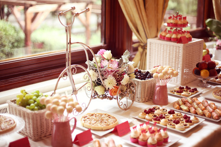 afternoon fancy cake: Table setting with flowers and sweets
