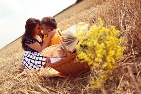 picnick: Couple laying on grass having picnick
