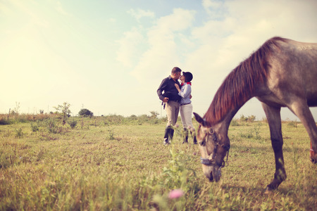 horse laugh: Happy couple with their horse