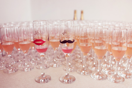campagne: Glasses for bride and groom and guests filled with campagne
