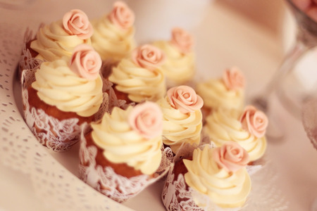 cake pick: Cupcakes with flower on top Stock Photo