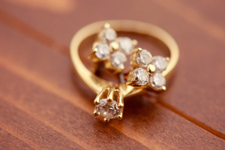 golden: Engagement ring with golden earrings Stock Photo