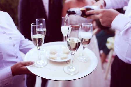 waiter serving: Waiter serving champagne