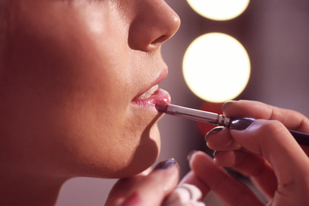 applying lipstick: Make up artist applying lipstick Stock Photo