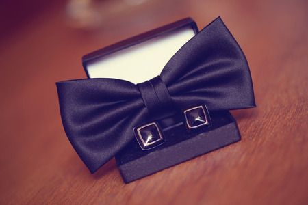 cuff links: Black cuff links and bowtie Stock Photo