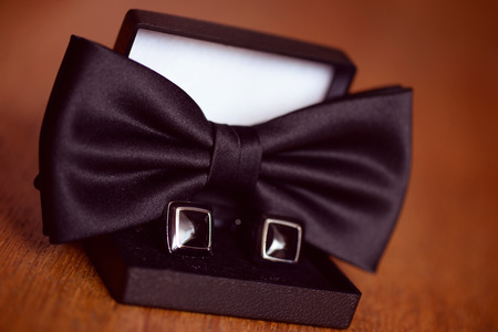 cuff link: Black cuff links and bowtie Stock Photo