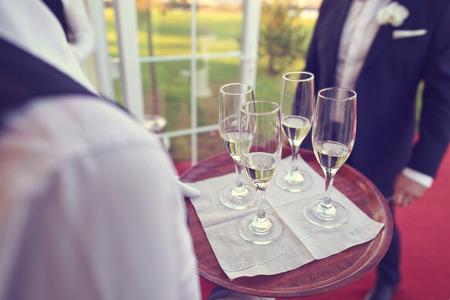 alcohol server: Waiter serving drink Stock Photo