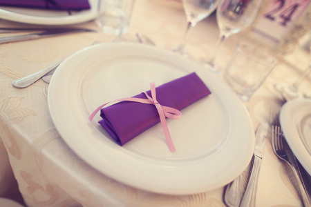 cater: Wedding plates with purple napkin