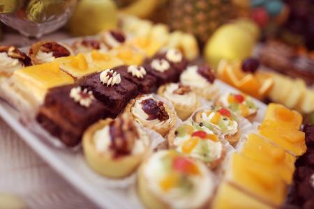 chocolaty: Mix of delicious small cakes Stock Photo