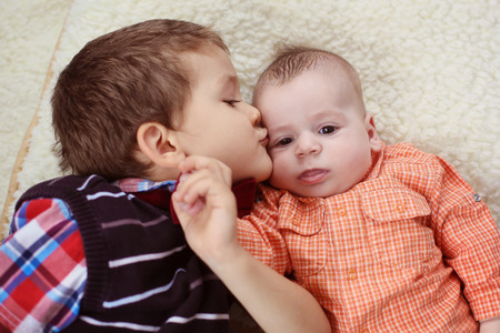 big brother: Big brother kissing the baby