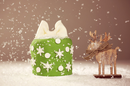 small cake: Green small cake with snow Stock Photo