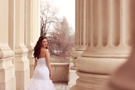 gals: Bride posing in architectural place Stock Photo