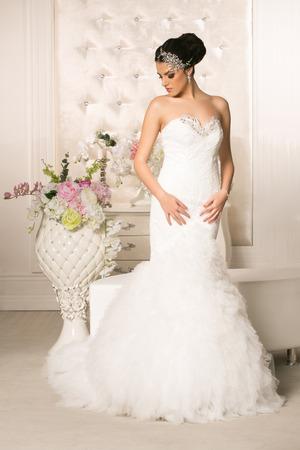 brides: Young attractive bride in wedding dress