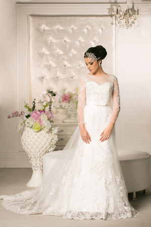 wedding portrait: Young attractive bride in wedding dress