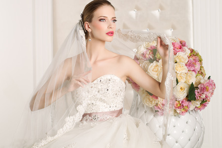 beautiful rose: Gorgeous bride in a white room