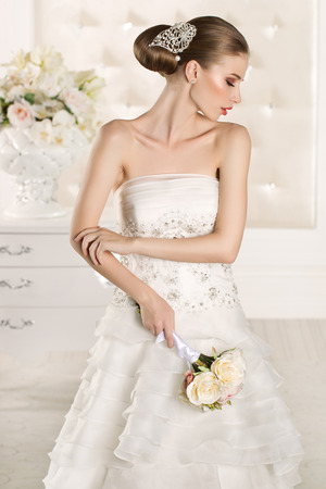 bride: Gorgeous bride in a white room