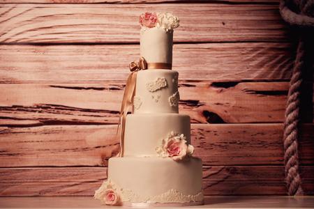 cake tier: 4 tier marzipan wedding cake