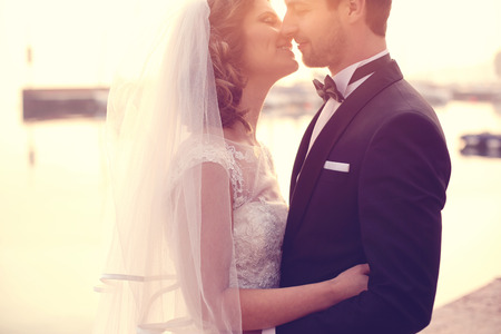 trash the dress: Close up of a bride and groom embracing