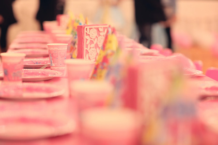 kids party: Pink plates for a birthday party Stock Photo