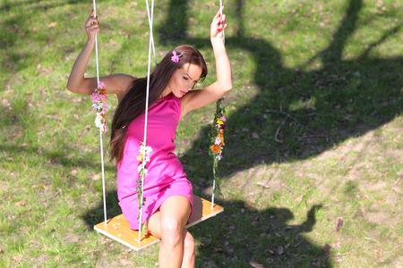 sexy pink: sexy pink purple dress lady on a swing Stock Photo
