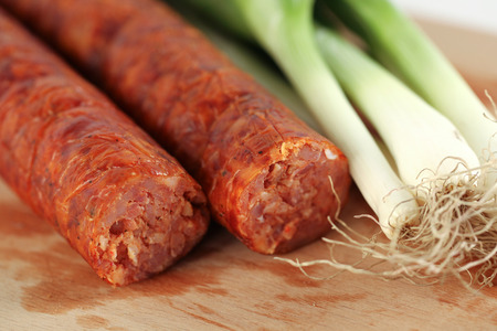 pork sausage: Delicious pork sausage with onion on wooden plate