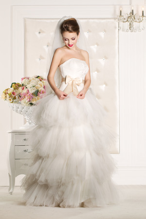 wedding gown: Gorgeous bride with white dress with flowers bouquet