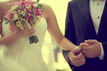 romantic couples: bride and groom holding hands
