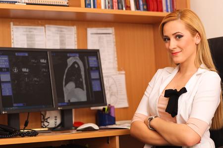 general pediatrician: female doctor sitting at her work desk Stock Photo