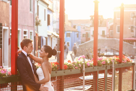 blonde couple: Bride and groom embracing in Venice, Italy