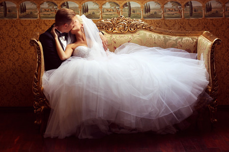 bride veil: Beautiful bridal couple kissing