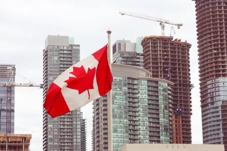 canadian flag: Canadian flag and Toronto city skyline