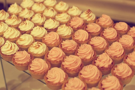 afternoon fancy cake: Delicious cupcakes on stand Stock Photo