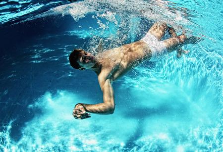 male underwear model: Sexy guy diving in pool underwater