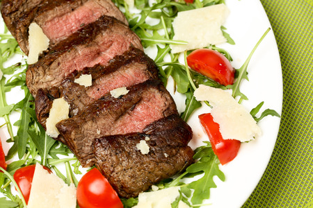 flank: Juicy flank of steak sliced with vegetables