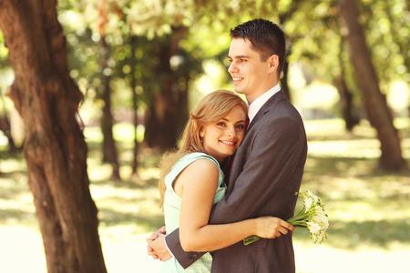 engaged: engaged couple celebrating in the park