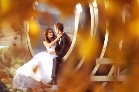 Beautiful bridal couple embracing near architecture