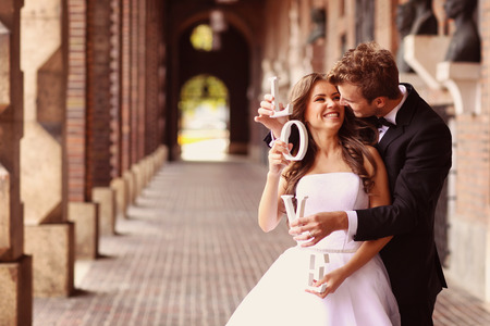 outdoor wedding: Beautiful bride and groom embracing in the city