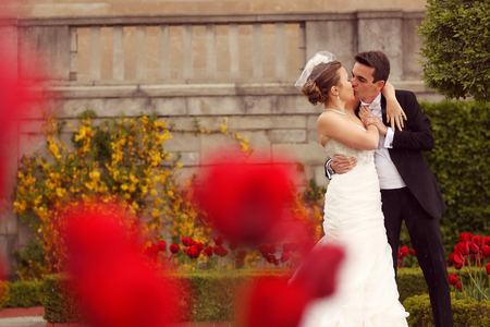 multi story: Bride and groom embracing in the park Stock Photo