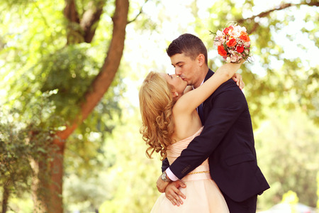 multi story: Beautiful bride and groom embracing in the park
