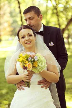 multi story: Happy bridal couple embracing in the park