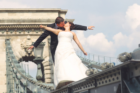 lviv: Beautiful bride and groom celebrating their wedding in the city