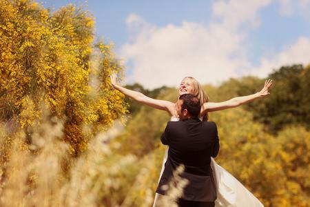 multi story: Joyful bride and groom having fun in nature